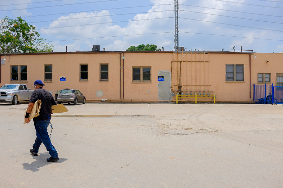 A man walks by 125 Blue Star. Photo by Scott Ball.