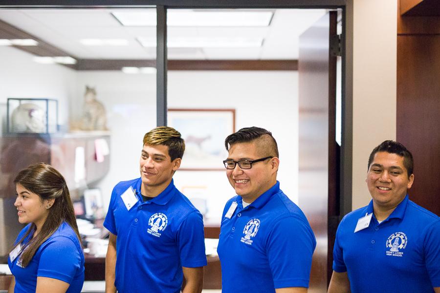 Lanier High School students watch employees of Frost Bank trade bonds. Photo by Scott Ball.