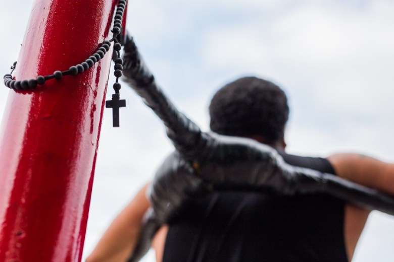 A rosary hangs ringside during a fight. Photo by Scott Ball.