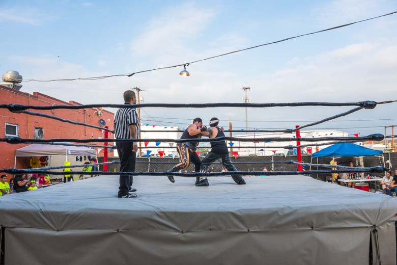 Two luchadors grapple each other. Photo by Scott Ball.