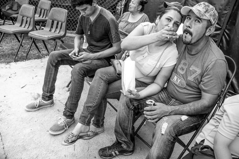 A woman feeds popcorn to her boyfriend. Photo by Scott Ball.