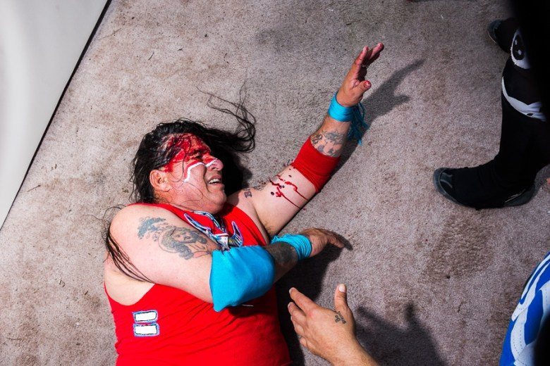 Chief Battu lays on the ground after being hit by a chair. Photo by Scott Ball.