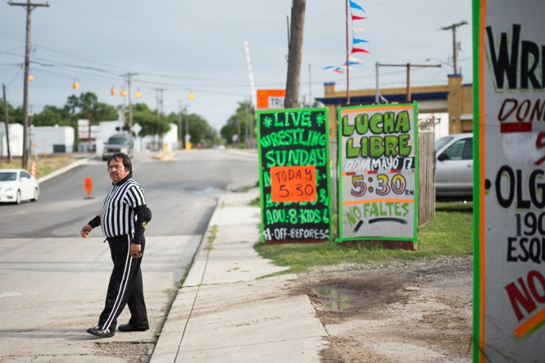 Referee Cementa walks across the street before the event. Photo by Scott Ball.