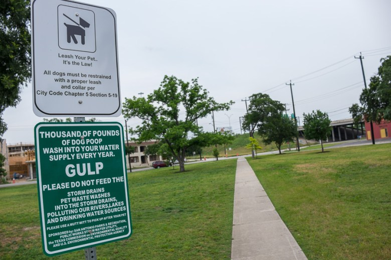 Signs pertaining to dog owners at Maverick Park. Photo by Scott Ball.