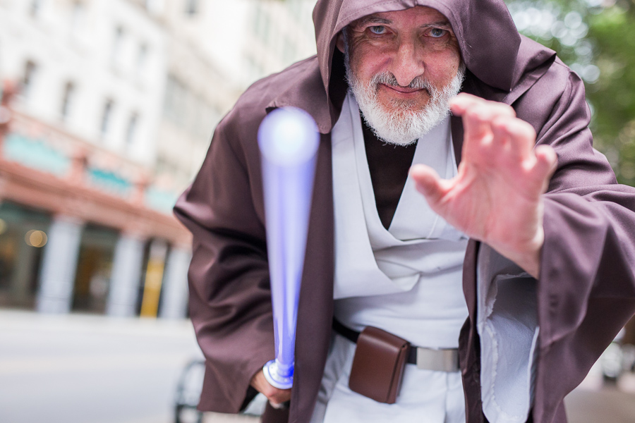 Jeff Whitted cosplaying Old Ben poses for a photo during the GDC Star Wars day benefiting the St. Baldrick's Foundation. Photo by Scott Ball.