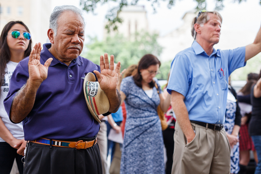 People worship during the National Day of Prayer at City Hall on Thursday. Photo by Scott Ball.