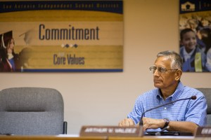 Arthurt Valdez listens during a special board meeting. Photo by Scott Ball.