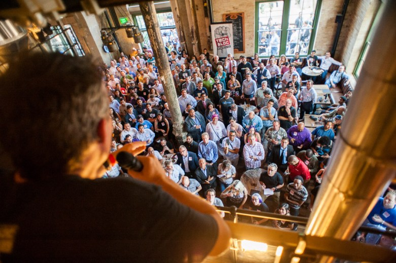 Lew Moorman speaks to a packed crowd. Photo by Scott Ball.