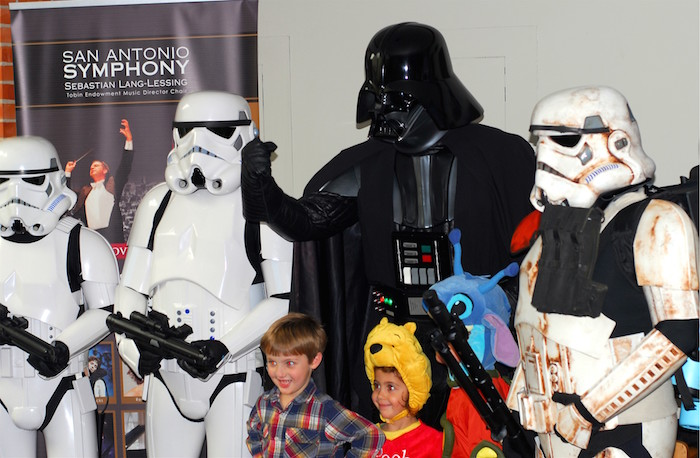 Volunteers dressed as Stars Wars characters took photos with children during the 2014 H-E-B Pops Series. Photo courtesy of the San Antonio Symphony.