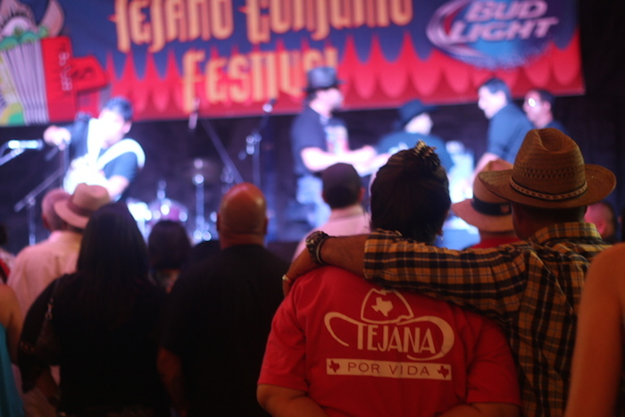 A bystander in the crowd at Rosedale Park shows off her Tejano roots and pride. Photo by Amanda Lozano.