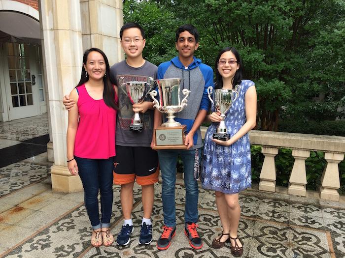 (l-r) Emily Ye, Christ Zhu, Nabil Kapasi, and Katie Mansfield at Keystone School with their Academic WorldQuest trophies. Photo by Bekah McNeel