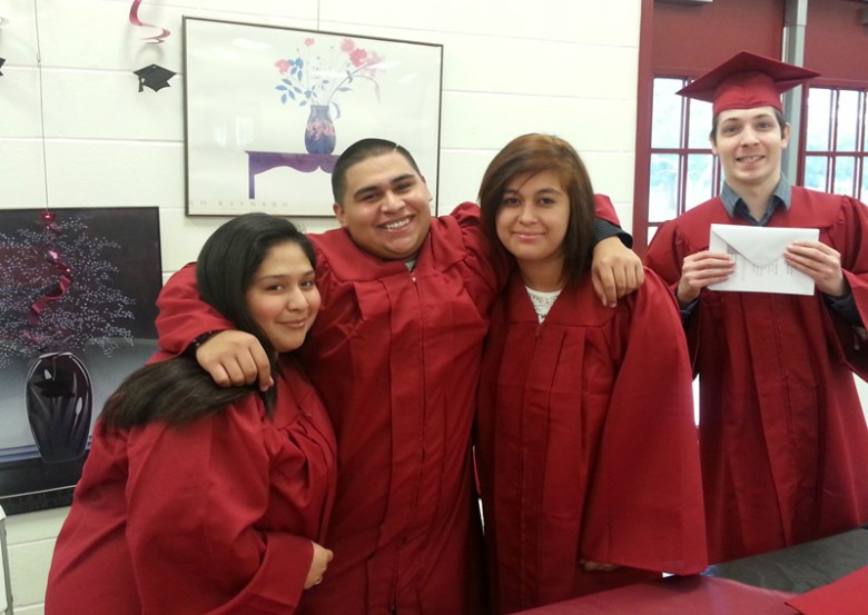 These students graduated from Por Vida Academy Charter High in 2015 – they are four of 50 graduates. Photo courtesy of Blessed Sacrament Academy.