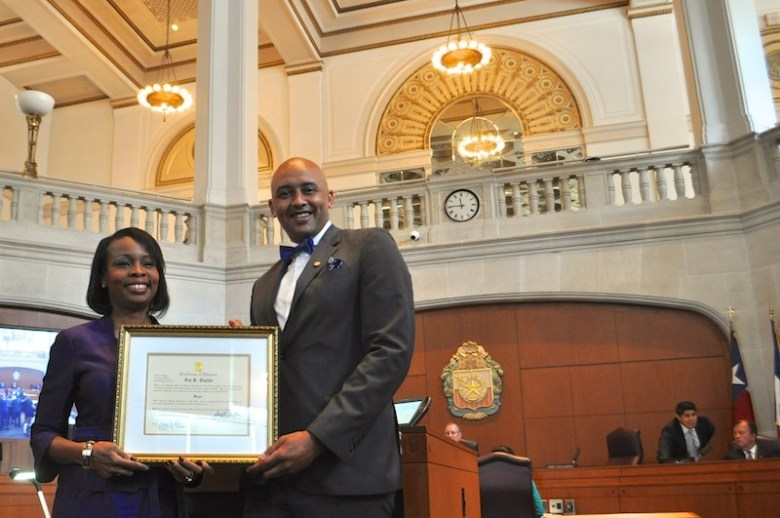 Mayor Ivy Taylor accepts an official proclamation of her election to serve as mayor for two more years from Councilmember Alan Warrick II (D2).