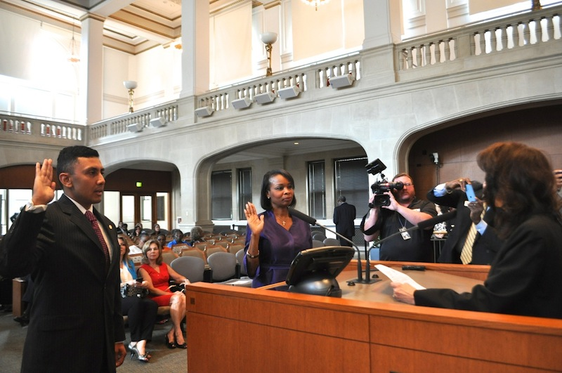 Councilmember Cris Medina (D7) and Mayor Ivy Taylor are sworn into office on Wednesday, June 24, 2015. Photo by Iris Dimmick.
