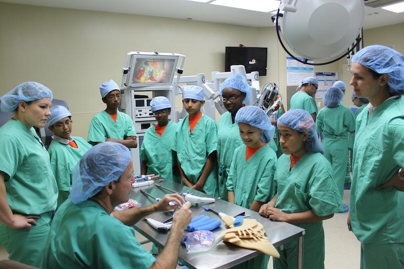 """Students surround Dr. Bala """"Vish"""" Vishwanathan at North Central Baptist Hospital. Courtesy photo."""