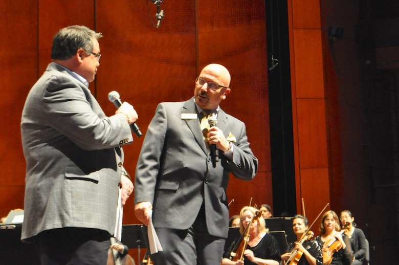"""SA Symphony President David Gross speaks with Alfredo """"Freddie"""" Cervera, an SA Symphony board member and president of the San Antonio Symphony League on stage at the Tobin Center. Photo by Iris Dimmick."""
