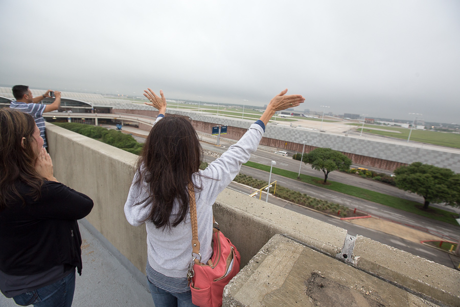 A family waves goodbye to a first time flyer. Photo by Scott Ball.