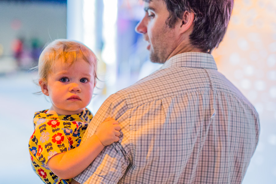 Moira holds onto her father Lewis McNeel as they walk through the DoSeum. Photo by Scott Ball.