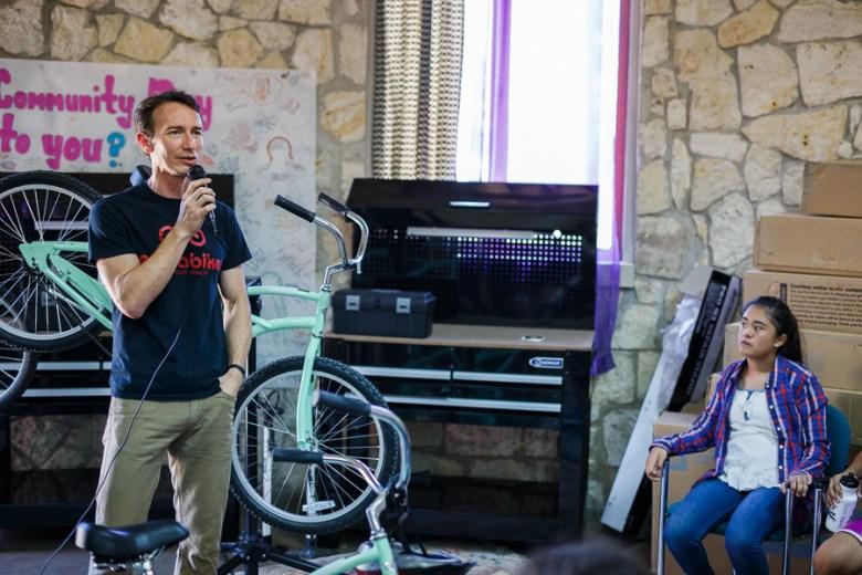 Cristian Sandoval speaks to the children. Photo by Scott Ball.