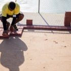 A volunteer lays a new walkway at Wheatley Middle School. Photo by Scott Ball.
