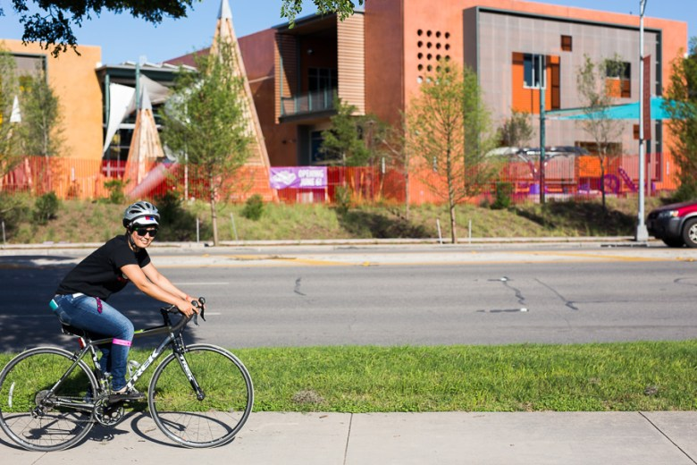 Edith Lopez Estrada rides her bike down the path. Photo by Scott Ball.
