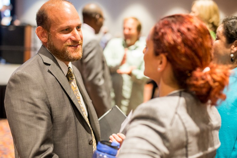 City of San Antonio Chief Sustainability Officer Douglas Melnick speaks with a guest. Photo by Scot Ball.