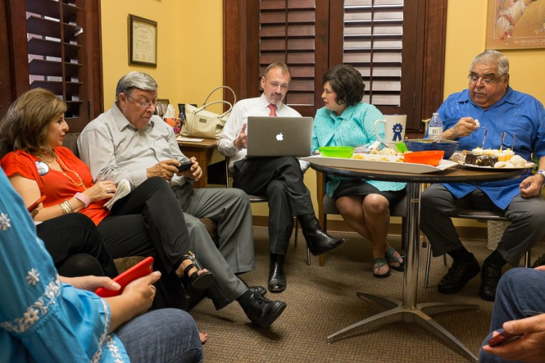 Campaign Manager Christian Archer reviewing results with Leticia Van de Putte. Photo by Scott Ball