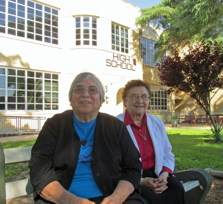 Sister Stephanie and Sister Odilia in front of the Blessed Sacrament Academy's  High School Building. Photo courtesy of Blessed Sacrament Academy.