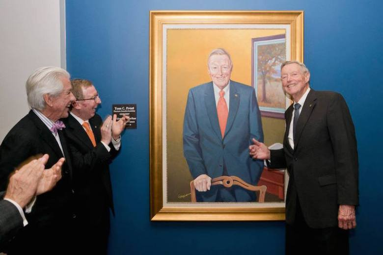 They share a likeness. Tom Frost smiles at the unveiling of his portrait, painted by Lionel Sosa. Photo by Lionel Sosa.