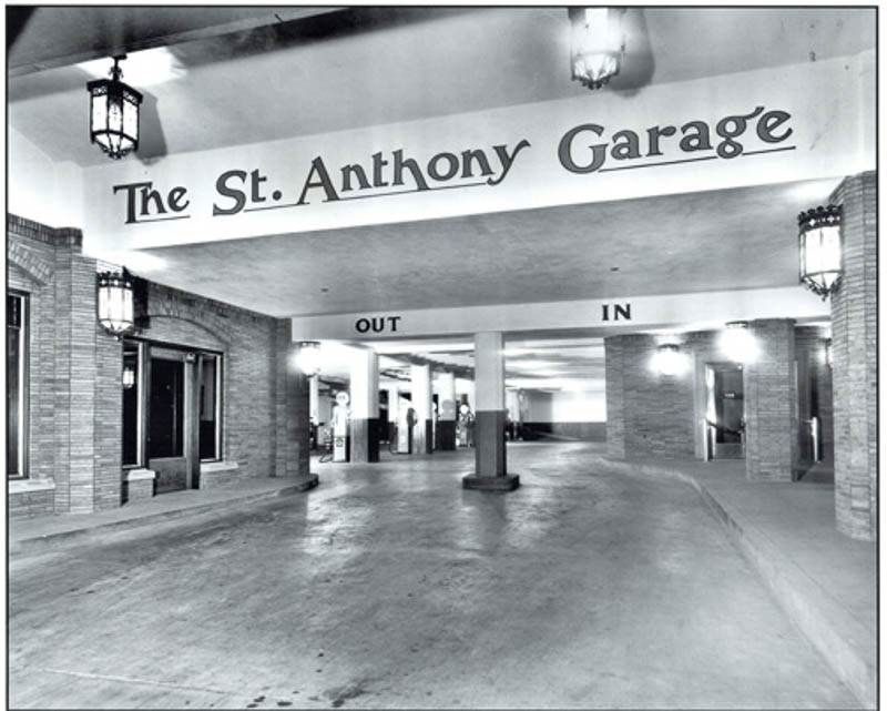 """Historic photo of the St. Anthony Hotel's garage. """"If you are traveling by car, use the unique auto-lobby and garage,"""" a brochure suggests. Courtesy image."""