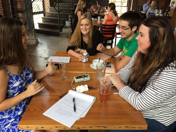 From left: Brainiacs Courtney Bryand, Whitney Ball, Dominic Dorsa, and Nicole Ahr discuss mentoring strategies at Rosella Coffee. Photo by Bekah McNeel.