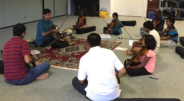Anandanada Yogi in class with his Indian classical violin students. Photo courtesy of Northside Music School.