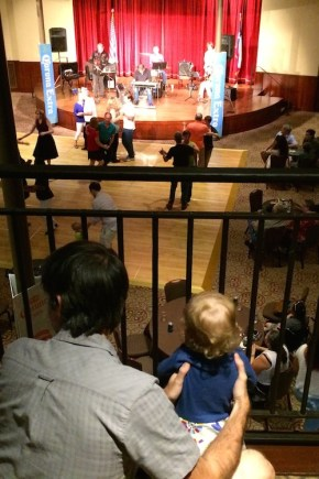 Urban Baby (right)) and her dad watch the dancers from the balcony of the Pearl Stables at the Summer Dance Hall Series. photo by Bekah McNeel.