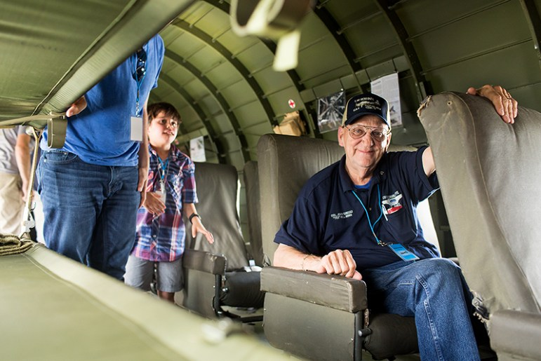 John Gibeau, a helicopter pilot during the Vietnam War, enjoys a ride on a C-47. Photo by Rachel Chaney.