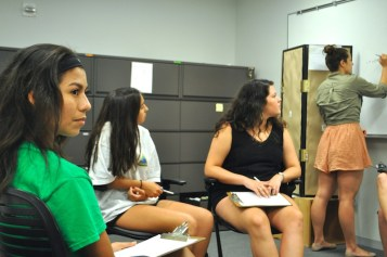 Alexandra Gamboa, a 19-year-old Trinity Student, sits in on a quick Body Project 4 High Schools session. Photo by Iris Dimmick.