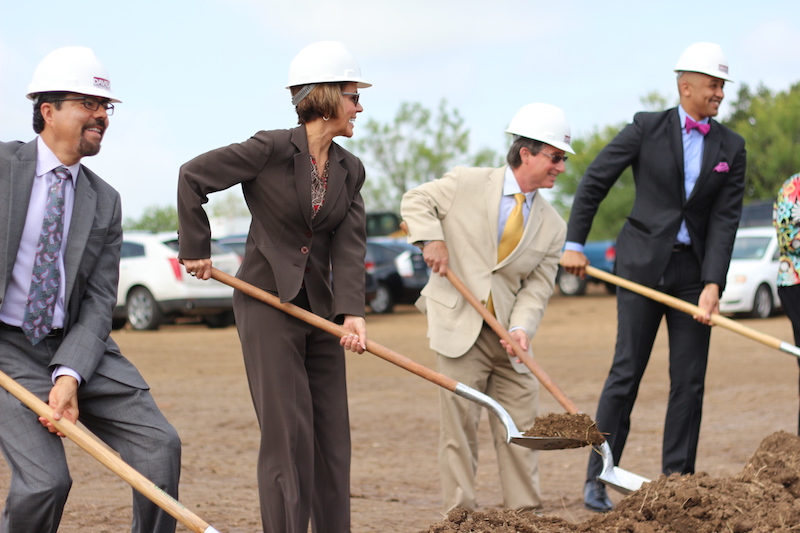 Ramiro S. Salazar, Sheryl Sculley, Sam Schaefer, and Alan E. Warrick shovel dirt to signify the project's beginning. Photo by Joan Vinson.
