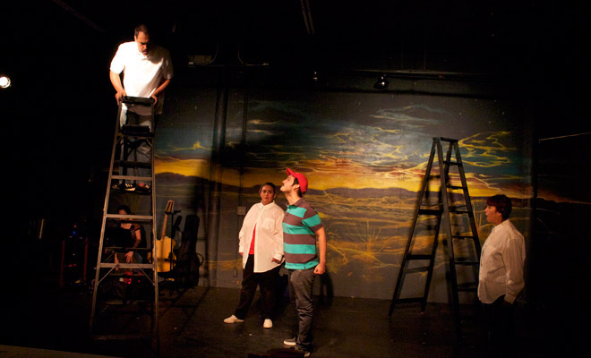 """Scene from """"Cuero"""" segment of """"Cuero, La Ruby Red, and El Big Bird"""" rehearsal (from left to right) Salvador Valadez, Janie Sauceda, Clint Taylor, and Marisela Barrera. Photo by Isaac H.  Medellin."""