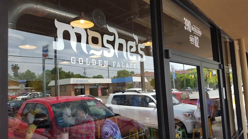 The outside window of Moshe's Golden Falafel. Photo by Winslow Swart.