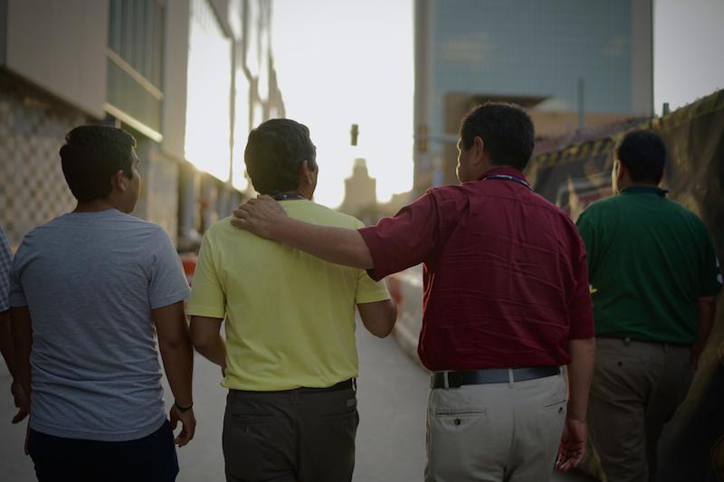 Conference attendees walk towards their hotel in downtown San Antonio. Photo by Joe Van Wyk.