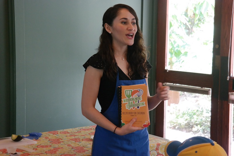Dietitian Celina Paras speaks to children about cooking with superfoods. Courtesy photo.