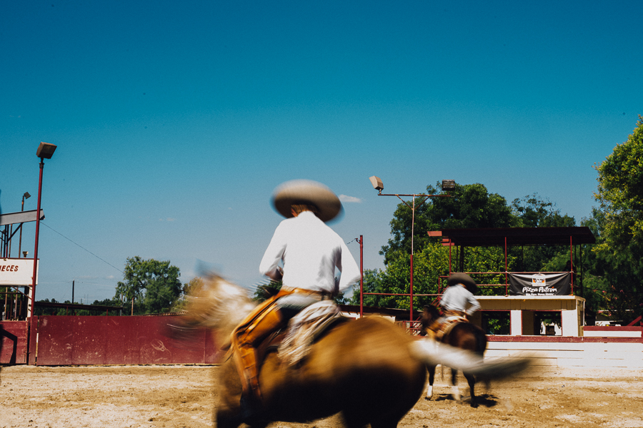 A charro practices before the Charreada begins. Photo by Scott Ball.