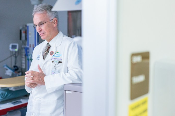 Doctor Mark Gilger stands in a pediatric trauma room.  Photo by Scott Ball.