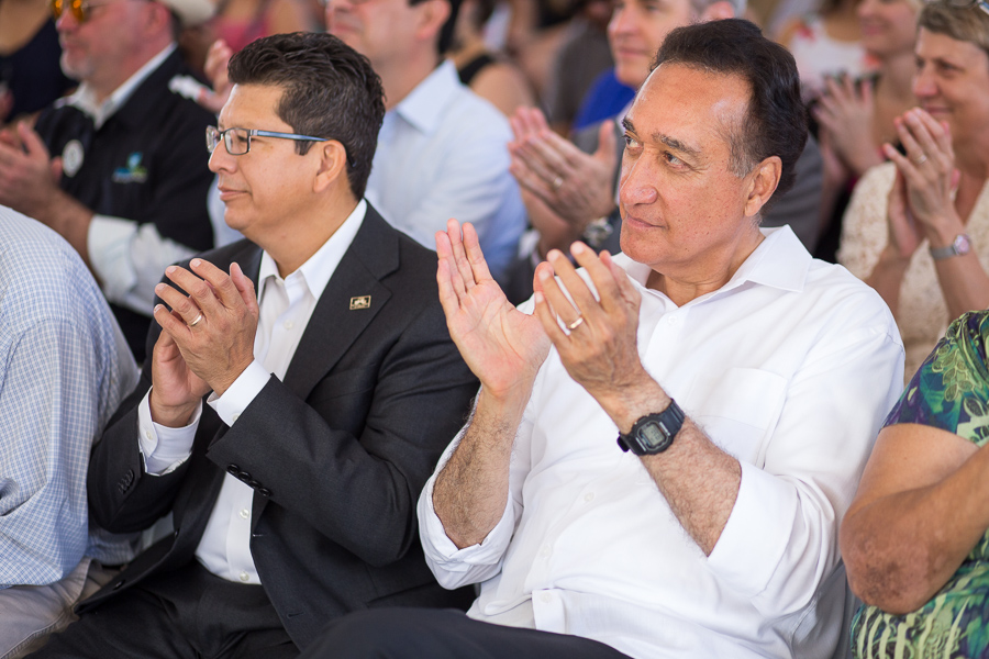 Richard Perez (left) and Henry Cisneros (right) applaud guests. Photo by Scott Ball.