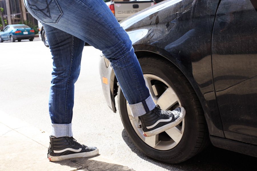 Marisela kicks her tire. Photo by Scott Ball.