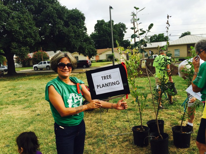 Jacqueline Salame shows off some of the new trees for planting.