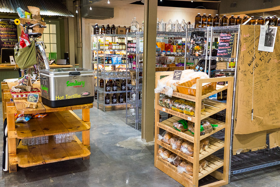 A fresh bread rack, hot tortillas, aisles, and a suggestion section all found in Blue Star Provisions. Photo by Scott Ball.