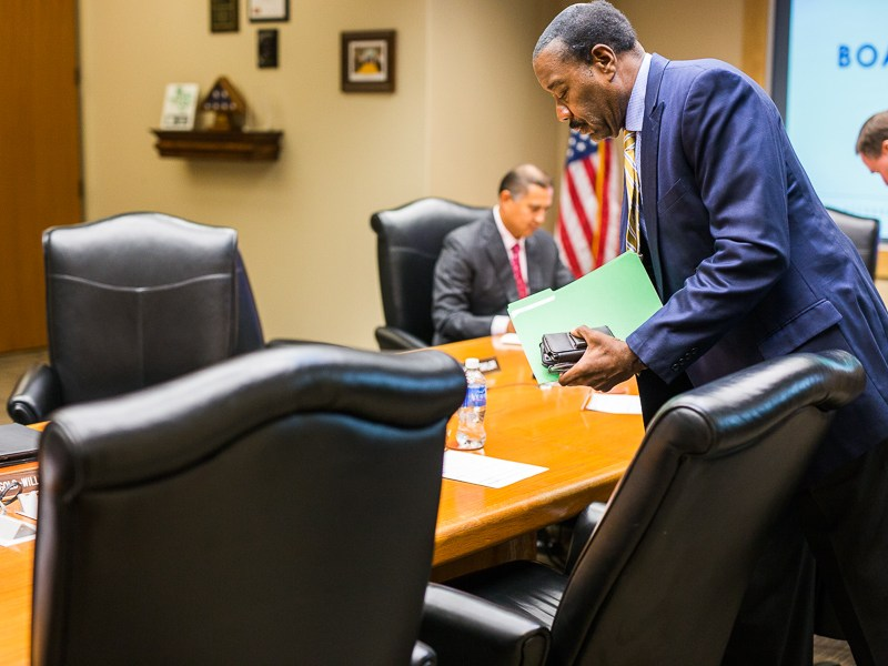 CPS Energy President and CEO Doyle Beneby gathers his belongings to exit the utility's board room. Photo by Scott Ball.
