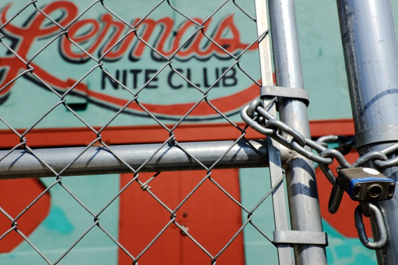 A locked fenced in front of Lermas Nite Club on North Zarzamora. Photo by Scott Ball.