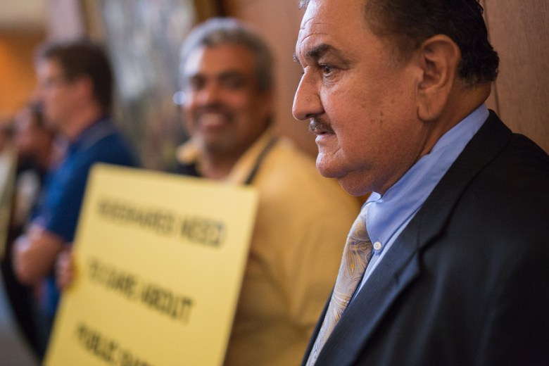 Owner of National Cab, Robert Gonzales, looks forward during the city council meeting. Photo by Scott Ball.