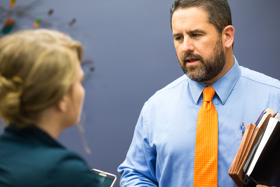 Deputy City Manager Erik Walsh speaks with reporter Iris Dimmick during the meeting. Photo by Scott Ball.